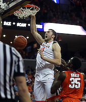 Virginia center Mike Tobey (10) dunks the ball over Clemson center Landry Nnoko (35) during an ACC basketball game Tuesday Jan. 19, 2016, in Charlottesville, Va. Virginia  defeated Clemson  69-62. (Photo/Andrew Shurtleff)