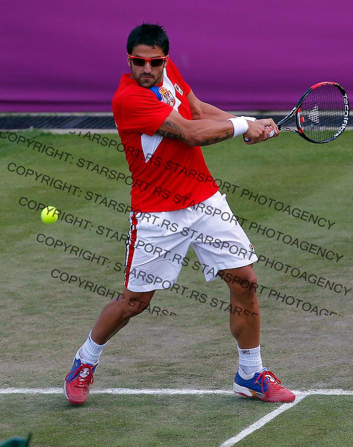 Olympic games London 2012.Tennis tournament.Janko Tipsarevic SRB v Philipp Petzschner GER.Janko Tipsarevic returnes the ball.London, 30.07.2012..foto: Srdjan Stevanovic/Starsportphoto ©