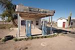 Abandoned and for sale 1940s era garage and gas station, Quartzite, Arizona
