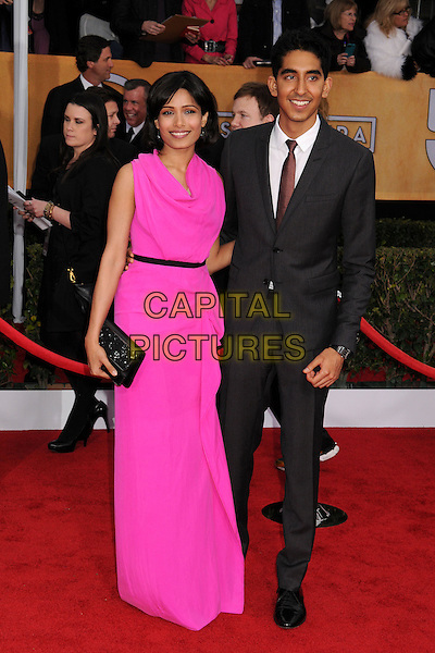 Freida Pinto (wearing Roland Mouret) & Dev Patel .Arrivals at the 19th Annual Screen Actors Guild Awards at the Shrine Auditorium in Los Angeles, California, USA..27th January 2013.SAG SAGs full length pink dress grey  gray suit couple black clutch bag draped.CAP/ADM/BP.©Byron Purvis/AdMedia/Capital Pictures