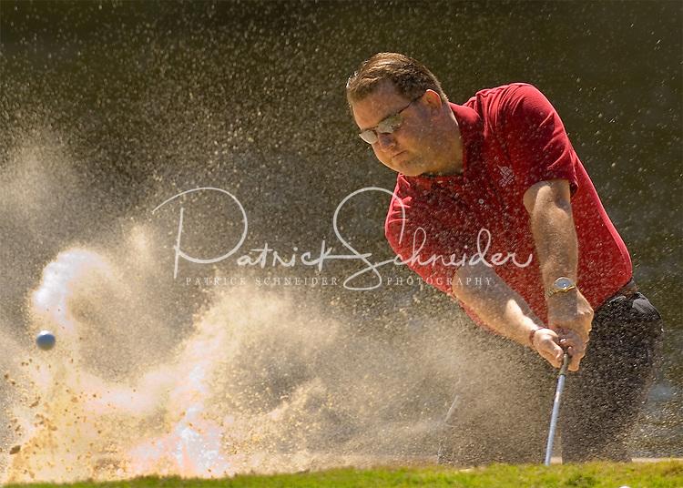 A golfer hits from a sand trap in Amelia Island, FL