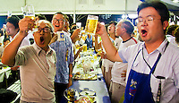 Salerymen let their hair down with a few beers & a good sing song at Tokyo`s Oktober Fest.