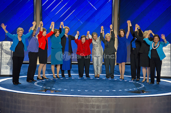 The Democratic Women of the US Senate raise their hands after making remarks during the fourth session of the 2016 Democratic National Convention at the Wells Fargo Center in Philadelphia, Pennsylvania on Thursday, July 28, 2016.   <br /> Credit: Ron Sachs / CNP/MediaPunch<br /> (RESTRICTION: NO New York or New Jersey Newspapers or newspapers within a 75 mile radius of New York City)