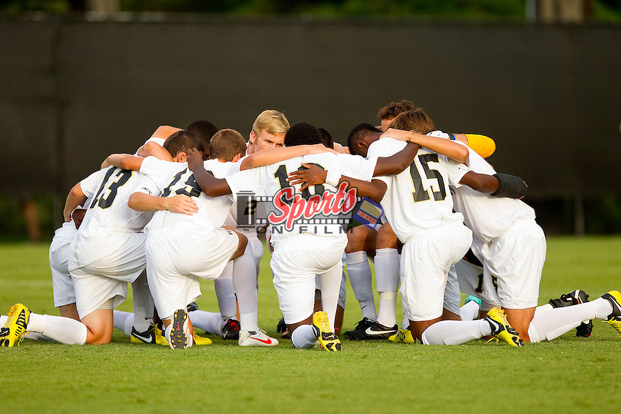 The Wake Forest Demon Deacons huddle up prior to the start of the game against the Wofford Terriers at Spry Soccer Stadium on August 25, 2012 in Winston-Salem, North Carolina.  The Demon Deacons defeated the Terriers 1-0.  (Brian Westerholt/Sports On Film)