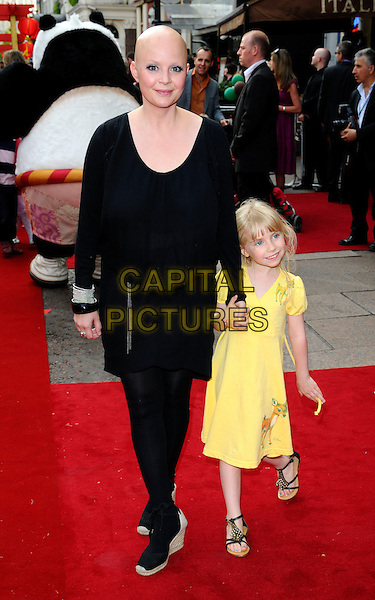 "GAIL PORTER & HONEY HIPGRAVE.UK Premiere of ""Kung Fu Panda"" held at the Vue West End, London, England, UK, .June 26th 2008.full length kid child daughter mother mom mum family yellow dress black wedges shoes tights holding hands .CAP/CAN.©Can Nguyen/Capital Pictures."
