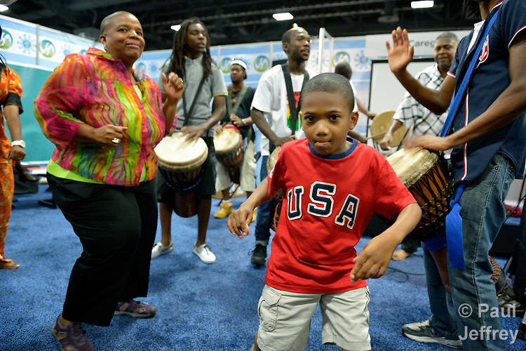 A boy enjoys dancing during a gathering in the Faith Zone of the Global Village at the XIX International AIDS Conference in Washington, D.C.  The Faith Zone was sponsored by the Ecumenical Advocacy Alliance.