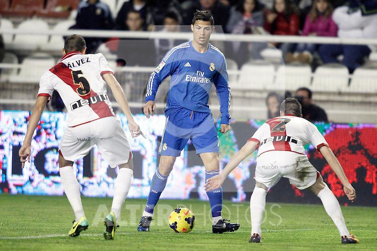 Rayo Vallecano's Alejandro Galvez (l) and Tito (r) and Real Madrid's Cristiano Ronaldo during La Liga match.November 22,2013. (ALTERPHOTOS/Acero)