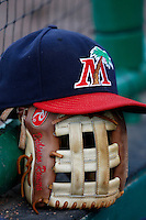 July 13, 2009:  Hat and glove of Third Baseman Deibinson Romero of the Fort Myers Miracle during a game at Hammond Stadium in Ft. Myers, FL.  Ft. Myers is the Florida State League High-A affiliate of the Minnesota Twins.  Photo By Mike Janes/Four Seam Images