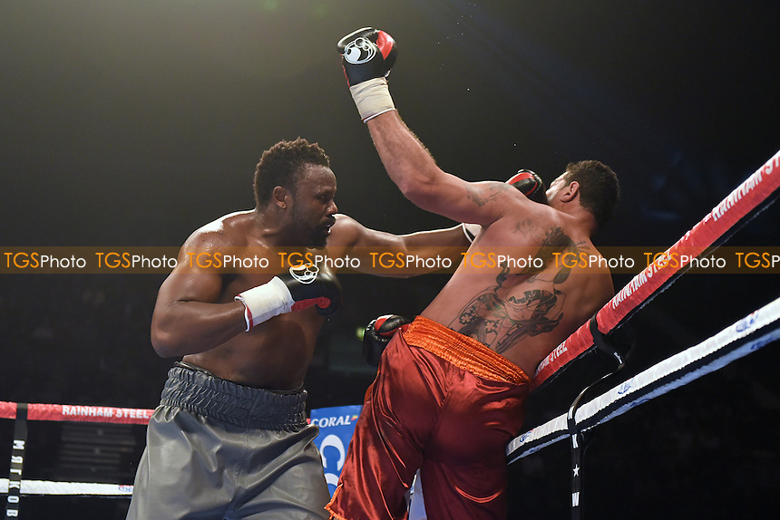 Dereck Chisora (grey shorts) defeats Marcelo Luiz Nascimento during a Boxing Show at Wembley Arena, London, England, promoted by Frank Warren on 26/09/2015