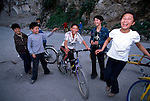 Children laughing near side of road; bikes; fun; rural China; Asia; outside town of Wuxi; 042503