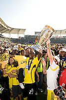 Ezra Hendrickson holds the MLS Cup trophy during MLS Cup 2008. Columbus Crew defeated the New York Red Bulls, 3-1, Sunday, November 23, 2008. Photo by John Todd/isiphotos.com