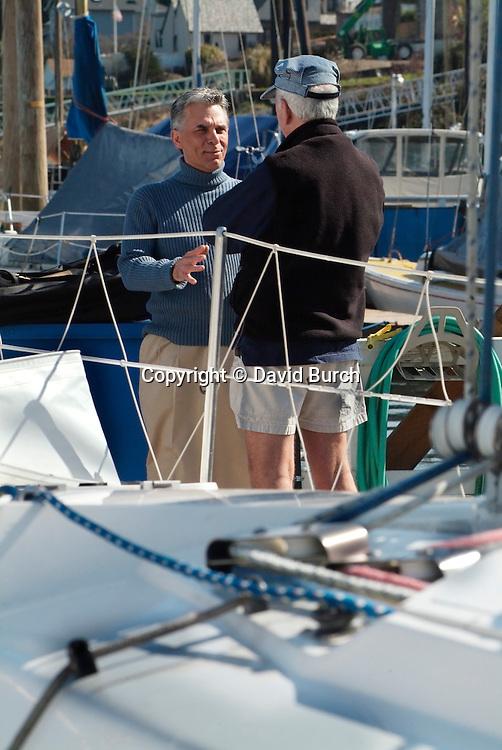 Two men talking at marina