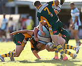 Kirisome Auva'a of the Cronulla Sharks is tackled hard by Brad Murray and Nathan Clarke of the Wyong Roos during Round 5 of the 2013 NSW Cup at Morrie Breen Oval on April 7, 2013 in Wyong, Australia. (Photo by Paul Barkley/LookPro)