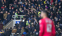 Police battle with supporters as a fight breaks out in the Oxford Stand during the Johnstone's Paint Trophy Southern Final 2nd Leg match between Oxford United and Millwall at the Kassam Stadium, Oxford, England on 2 February 2016. Photo by Andy Rowland / PRiME Media Images.