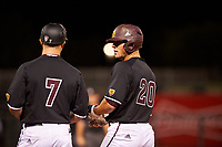 ASU Sun Devils Spencer Torkelson (20) talks to his first base coach during an Instructional League game against the Texas Rangers at Surprise Stadium on October 6, 2018 in Surprise, Arizona. (Zachary Lucy/Four Seam Images)