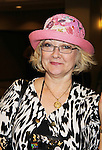 Author Linnea Sinclair - published author tries on Jane Elissa Hat at Romantic Times Booklovers Annual Convention 2011 - The Book Industry Event of the Year - April 9, 2011 at the Westin Bonaventure, Los Angeles, California for readers, authors, booksellers, publishers, editors, agents and tomorrow's novelists - the aspiring writers. (Photo by Sue Coflin/Max Photos)