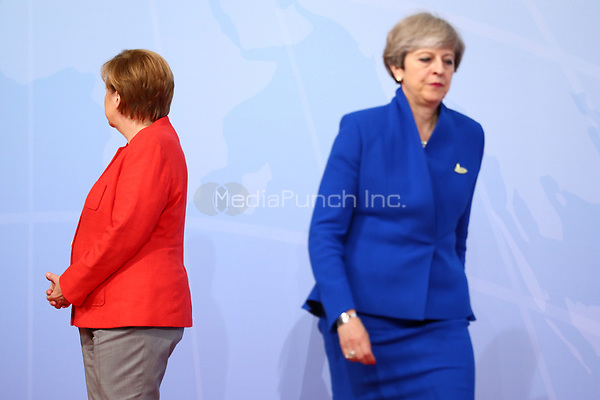 German chancellor Angela Merkel greets the British prime minister Theresa May at the G20 summit in Hamburg, Germany, 7 July 2017. The heads of the governments of the G20 group of countries are meeting in Hamburg on the 7-8 July 2017. Photo: Christian Charisius/dpa /MediaPunch ***FOR USA ONLY***