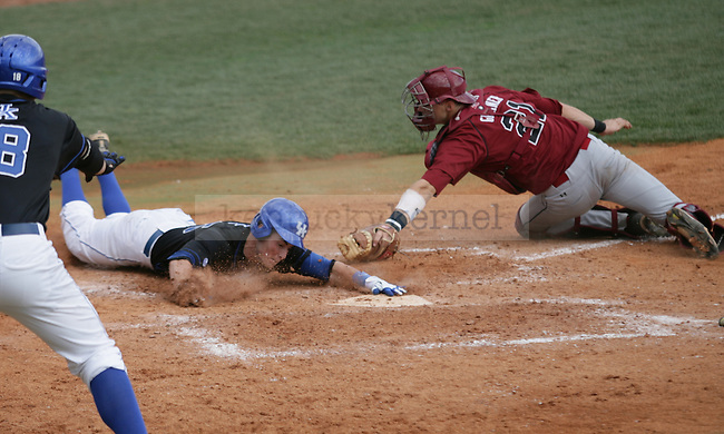Senior infielder Thomas McCarthy slides into home to score during the final game of the UK vs. South Carolina series in Lexington, Ky., on 3/18/12. Photo by Brandon Goodwin | Staff