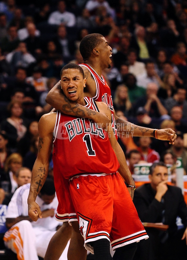 Jan. 22, 2010; Phoenix, AZ, USA; Chicago Bulls guard (1) Derrick Rose celebrates with forward (24) Tyrus Thomas after a dunk against the Phoenix Suns in the fourth quarter at the US Airways Center. Chicago defeated Phoenix 115-104. Mandatory Credit: Mark J. Rebilas-