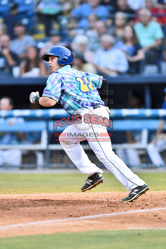 Asheville Hippies catcher Brian Serven (25) runs to first base during a game against the Greenville Drive at McCormick Field on June 29, 2017 in Asheville, North Carolina. The Drive defeated the Tourists 9-6. (Tony Farlow/Four Seam Images)