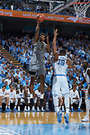 Doral Moore (4) of the Wake Forest Demon Deacons shoots over Garrison Brooks (15) of the North Carolina Tar Heels during first half action at the Dean Smith Center on December 30, 2017 in Chapel Hill, North Carolina.  The Tar Heels defeated the Demon Deacons 73-69.  (Brian Westerholt/Sports On Film)