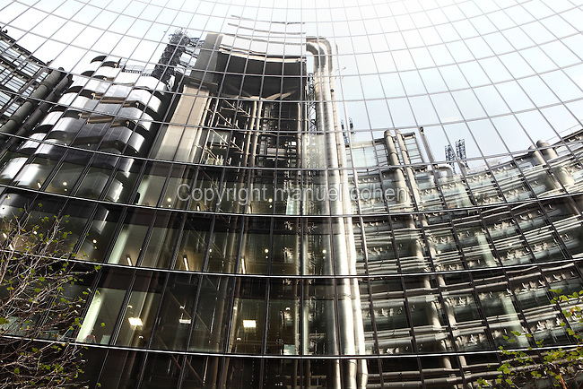 Lloyd's building reflected in the Willis Building, London, UK. Picture by Manuel Cohen