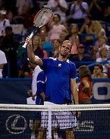 Xavier Malisse salutes the crowd during the Legg Mason Tennis Classic at the William H.G. FitzGerald Tennis Center in Washington, DC.  Unseeded Xavier Malisse defeated American John Isner in three sets in a thunderstorm delayed evening session.