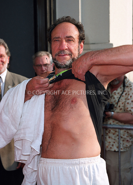 """Freshly done chest waxing""..F. Murray Abrahm attending a screening of ""Never Again"" in New York, July 8, 2002. Please byline: Alecsey Boldeskul/NY Photo Press.   ..*PAY-PER-USE*      ....NY Photo Press:  ..phone (646) 267-6913;   ..e-mail: info@nyphotopress.com"