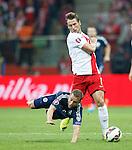Shaun Maloney fouled by Grzegorz Krychowiak