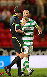 St Johnstone v Celtic..27.10.10  .Daniel Majstorovic argues with ref Craig Thomson.Picture by Graeme Hart..Copyright Perthshire Picture Agency.Tel: 01738 623350  Mobile: 07990 594431