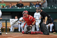 Palm Beach Cardinals catcher Carson Kelly (19) and home plate umpire Ryan Doherty look to third base to check the runner after a pitch in the dirt during a game against the Lakeland Flying Tigers on April 13, 2015 at Joker Marchant Stadium in Lakeland, Florida.  Palm Beach defeated Lakeland 4-0.  (Mike Janes/Four Seam Images)