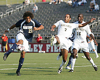 04 September 2009: Justin Morrow #21 of the University of Notre Dame shoots past Nick Courtney #7 and Kyle Adams #16 of Wake Forest University during an Adidas Soccer Classic match at the University of Indiana in Bloomington, In. The game ended in a 1-1 tie..