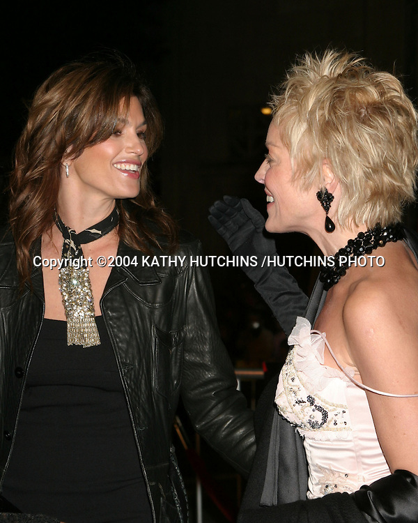 "©2004 KATHY HUTCHINS / HUTCHINS PHOTO.PREMIERE OF ""OCEANS 12"".LOS ANGELES, CA  .DECEMBER 8, 2004..CINDY CRAWFORD.SHARON STONE."