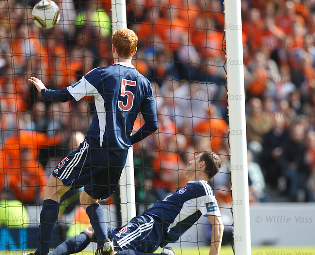 David Goodwillie's lob ends up in the Ross County net as defenders scramble back in vain