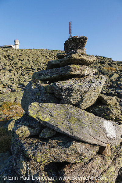 Rock cairn with white trail blaze on it at the summit of Mount Washington in the White Mountains, New Hampshire USA