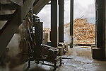 Rum Factory at Bellevue interior machinery and sugar cane pile