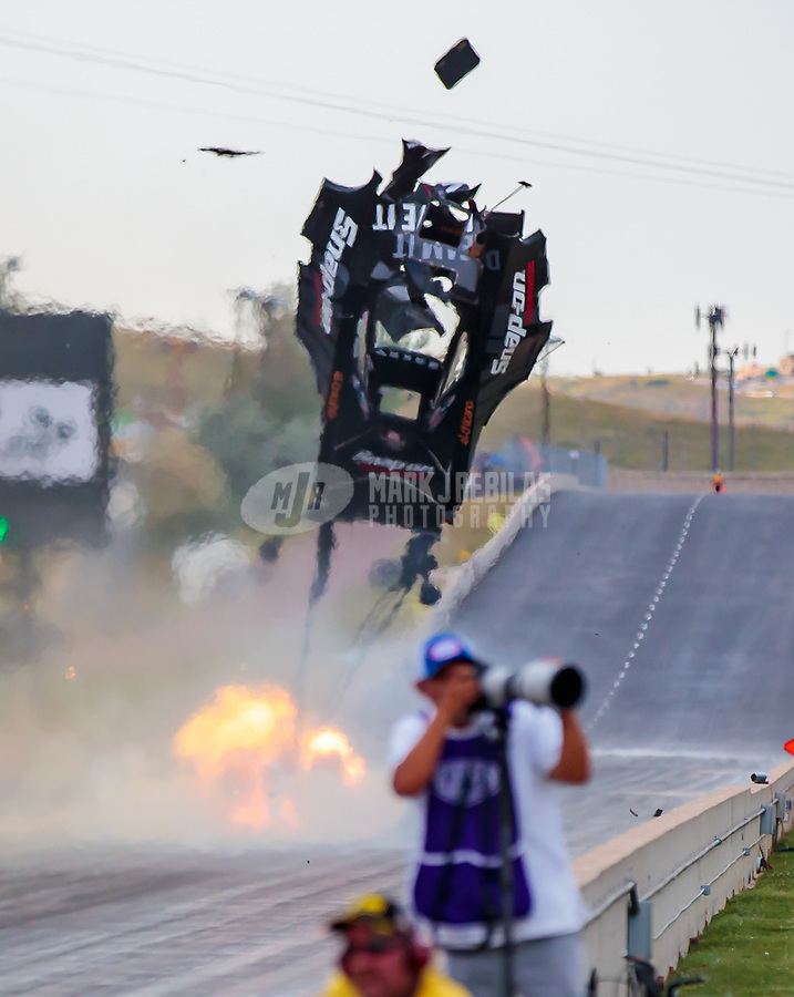 Jul 20, 2018; Morrison, CO, USA; NHRA funny car driver Cruz Pedregon explodes an engine throwing the carbon fiber body off his car during qualifying for the Mile High Nationals at Bandimere Speedway. Pedregon was uninjured. Mandatory Credit: Mark J. Rebilas-USA TODAY Sports