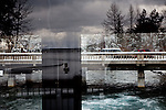 Lake Tahoe is reflected in the windows of the Lake Tahoe Dam as the Truckee River flows out in the background in Tahoe City, Calif., February 28, 2012..