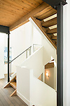 Graphic image of a stairwell with metal railings and wood stairs in a contemporary home. This image is available through an alternate architectural stock image agency, Collinstock located here: http://www.collinstock.com