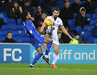 Bolton Wanderers' Filipe Morais vies for possession with Cardiff City's Armand Traore<br /> <br /> Photographer Kevin Barnes/CameraSport<br /> <br /> The EFL Sky Bet Championship - Cardiff City v Bolton Wanderers - Tuesday 13th February 2018 - Cardiff City Stadium - Cardiff<br /> <br /> World Copyright &copy; 2018 CameraSport. All rights reserved. 43 Linden Ave. Countesthorpe. Leicester. England. LE8 5PG - Tel: +44 (0) 116 277 4147 - admin@camerasport.com - www.camerasport.com