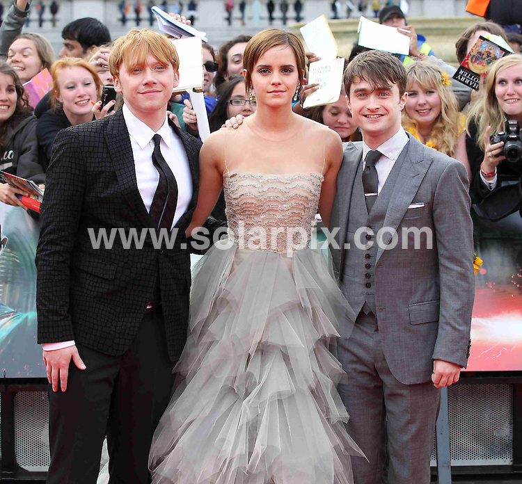 **ALL ROUND PICTURES FROM SOLARPIX.COM**                                             **WORLDWIDE SYNDICATION RIGHTS**                                                                                  Caption: arrivals at the World Premiere of Harry Potter and The Deathly Hallows - Part 2, Trafalgar Square, London, UK. 7 July 2011 This pic: Rupert Grint, Emma Thompson, Daniel Radcliffe                                                                                                                                                                 JOB REF: 13680 CPT       DATE: 07_07_2011                                                           **MUST CREDIT SOLARPIX.COM OR DOUBLE FEE WILL BE CHARGED**                                                                      **MUST AGREE FEE BEFORE ONLINE USAGE**                               **CALL US ON: +34 952 811 768 or LOW RATE FROM UK 0844 617 7637**