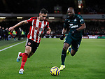 George Baldock of Sheffield Utd and Jetro Willems of Newcastle United during the Premier League match at Bramall Lane, Sheffield. Picture date: 5th December 2019. Picture credit should read: Simon Bellis/Sportimage