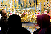 Muslim women at jewelry shop in The Grand Bazaar, Kapalicarsi, great market in Beyazi, Istanbul, Turkey