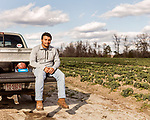 December 30, 2016. Rose Hill, North Carolina.<br /> <br /> John Dunn sits on the bed of his truck in a field owned by Cottles Organics, a farm where he has worked since he was a child. <br />  <br /> John Dunn, age 19, is currently a freshman at NC State University and is the first person in his family to go to college. With a combination of grants, loans, help from his grandfather and weekend farm work, Dunn hopes to find finish college and find a career in agriculture.<br /> <br />  Colleges and universities, which are always trying to pinpoint an under-served and sometimes underprivileged populations of students, have noted a decline in students from rural areas of the country. There are various efforts underway in colleges and universities to identify more of these kids and get them enrolled.