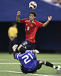 15 July 2007: Chile's Hans Martinez (17) lofts the ball over Nigeria goalkeeper Ikechukwu Ezenwa (21), assisting on the first Chile goal in the 96th minute. Chile's Under-20 Men's National Team defeated Nigeria's Under-20 Men's National Team 4-0 after extra time in a  quarterfinal match at Olympic Stadium in Montreal, Quebec, Canada during the FIFA U-20 World Cup Canada 2007 tournament.