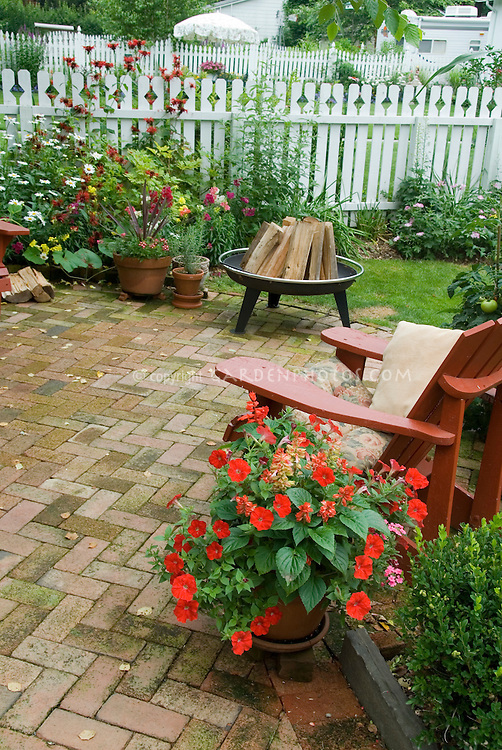 backyard brick patio firepit red adirondack chair pots. Black Bedroom Furniture Sets. Home Design Ideas