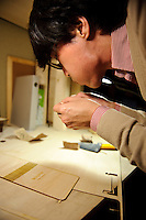 Assembling a wooden notepad holder, FabLab, Kamakura, Kanagawa Pref, Japan, December 9, 2011.