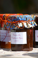 Jars pots of marmalade jam confiture of fruits and berries covered with colourful Provencal cloth Clos des Iles Le Brusc Six Fours Cote d'Azur Var France