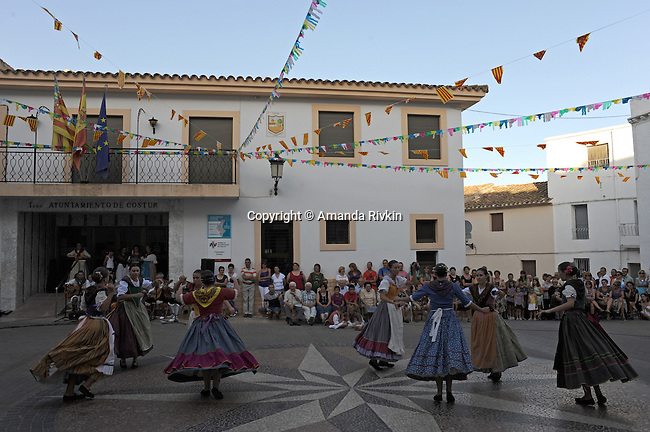 Young women perform traditional dances of the Valencian region in the main square during the municipal fiestas in the town of Costur, Spain on August 15, 2009.