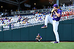 OMAHA, NE - JUNE 26: Jared Poche' (16) of Louisiana State University prepares before his team takes on the University of Florida during the Division I Men's Baseball Championship held at TD Ameritrade Park on June 26, 2017 in Omaha, Nebraska. The University of Florida defeated Louisiana State University 4-3 in game one of the best of three series. (Photo by Jamie Schwaberow/NCAA Photos via Getty Images)